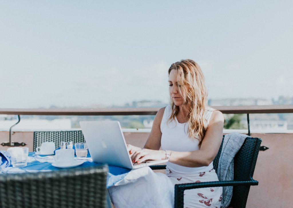 woman on balcony self-isolating during the Coronavirus crisis